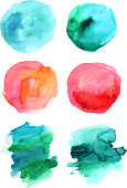 Set of abstract watercolour stains in various hues, vector