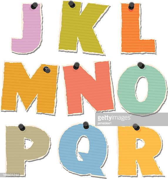 Set of assorted alphabet letters pinned on white background