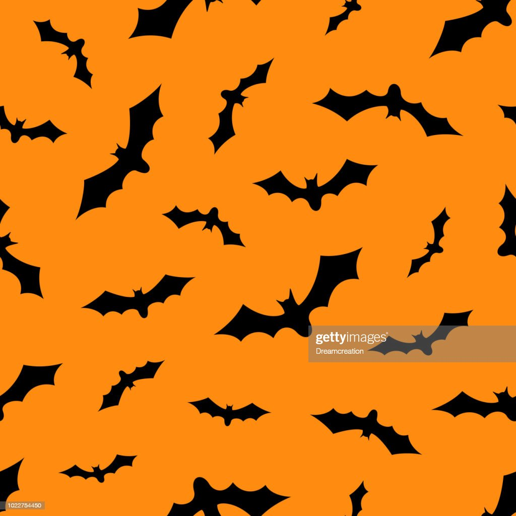 Set of bats silhouettes flying isolated on orange background