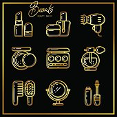 Set of beauty cosmetics icons drawn in gold lines on a black background_1