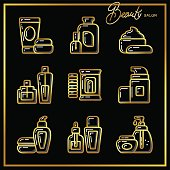 Set of beauty cosmetics icons drawn in gold lines on a black background_2