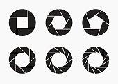 Set of black camera lens aperture icons.