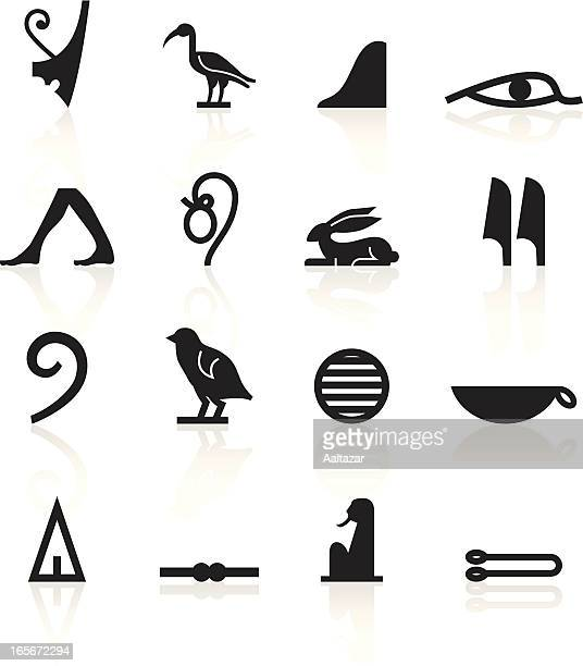 Set of black hieroglyphics symbols with shadows on white
