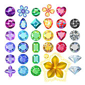 Set of colored gems and golden metal pattern flower