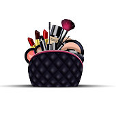Set of cosmetics with black bag on isolated background