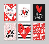 Set of cute Valentine's Day greeting cards with handwritten brush calligraphy and decorative elements.