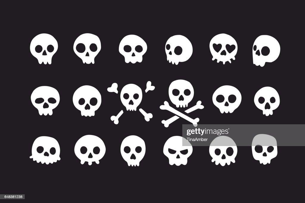 Set of doodle skulls with bones