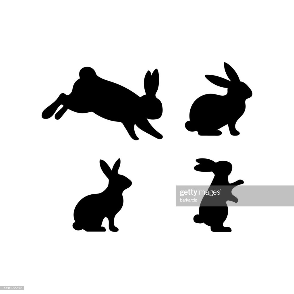 A set of Easter rabbits silhouette in different shapes and actions