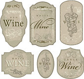 Set of elegant wine bottle labels sketchy grapes and leaves