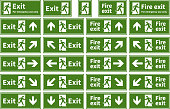 Set of emergency fire exit green signs on white