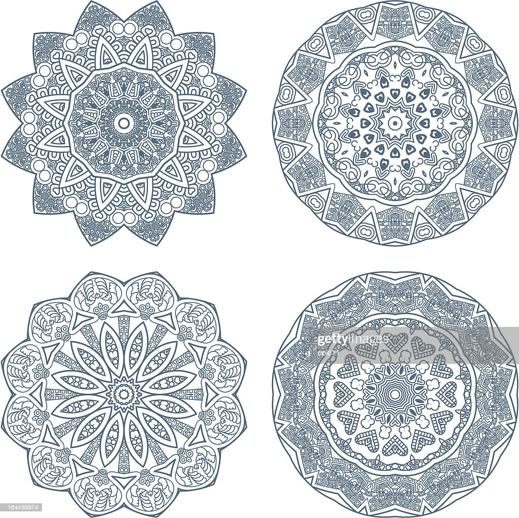 Set of four ornamental patterns in blue and white