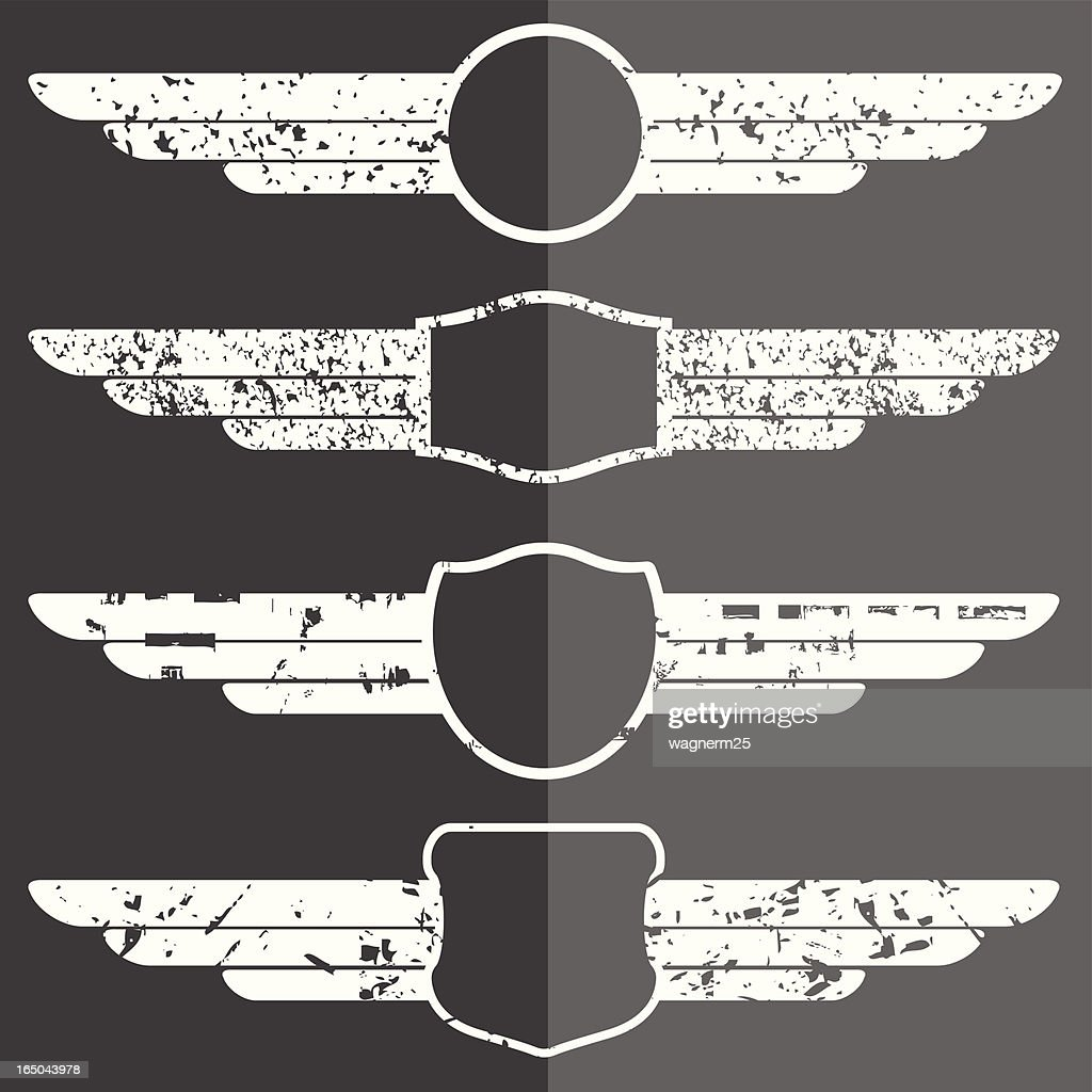 Set of four winged grunge emblems