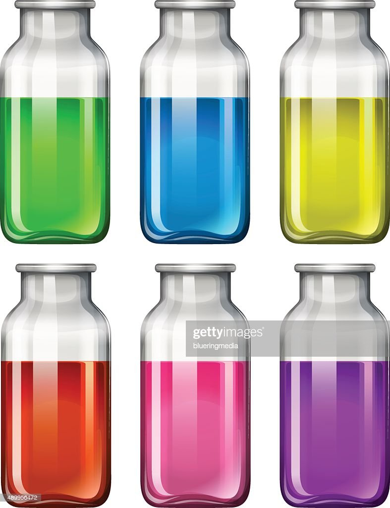 Set of glass bottles with colorful liquid