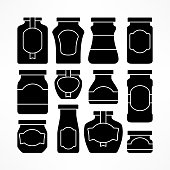 Set of glass jars with labels in black