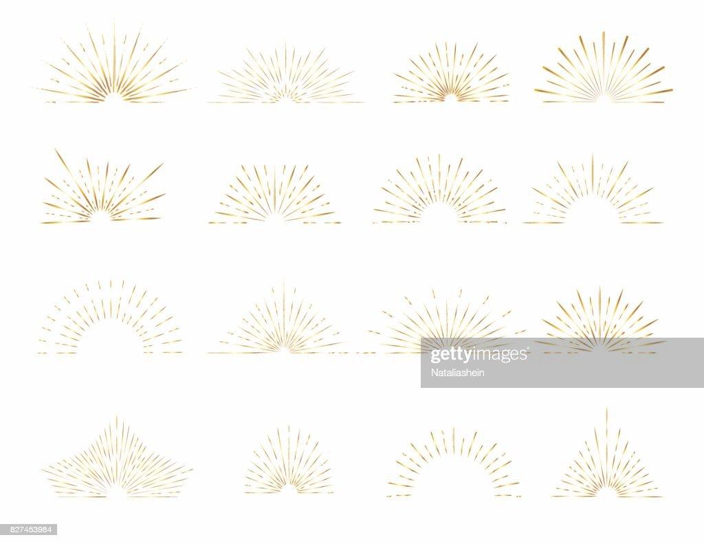 Set of gold sunburst rays design elements.