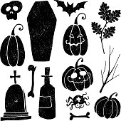 Set of grunge Halloween graphic elements. Black hand-drawn icons of pumpkins, coffin, tomb, spider, skull, and bat isolated on white background