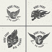 Set of hand drawn biker emblems. Skull with fire, winged wheel.