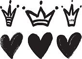 Set of hand drawn hearts and crowns.