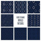Set of hand drawn indigo blue patterns. Seamless vector navajo backgrounds with triangles, arrows, rhombuses and diamonds