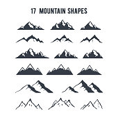 Set of hand drawn mountain silhouettes. Mountains peaks for creating logo, badges and emblems.