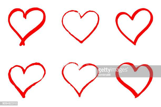 set of hand drawn red vector hearts on white background - heart symbol stock illustrations