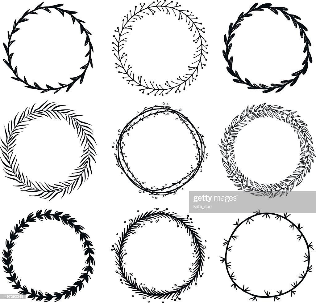 Set of hand drawn wreaths. Design elements