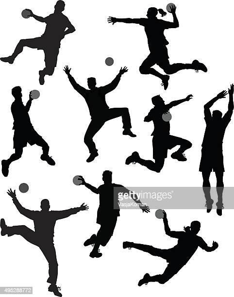 set of handball players silhouetes - handball stock illustrations