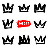 Set of hand-drawn crowns isolated on white background. Rough graffiti shapes. Doodle style abstract ink grunge texture. Logo vector collection.