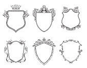 Set of heraldic shields, line art