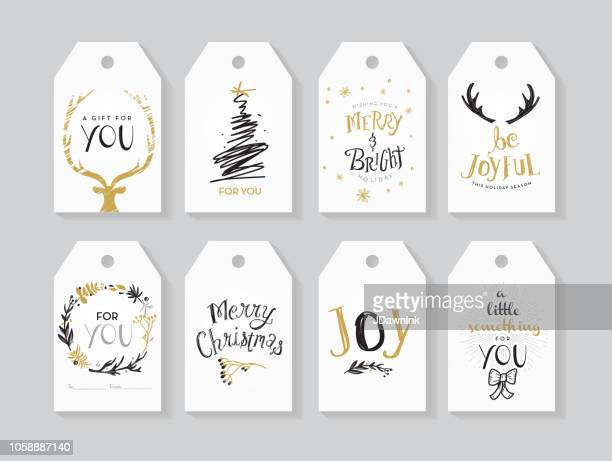 set of holiday christmas gift tags with greeting designs and holiday elements - deer stock illustrations