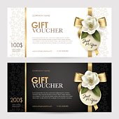 Set of luxury gift voucher with a gold bow, ribbon and flower.