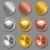 Set of medals of various shapes on gray background. Metallic badges. Gold, silver and bronze  awards. Medals template. Coins.