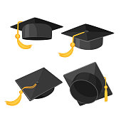 Set of mortarboard caps with golden tassels from different sides