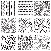Set of nine black and white seamless hand drawn texture pattern designs for backgrounds, vector illustration collection.