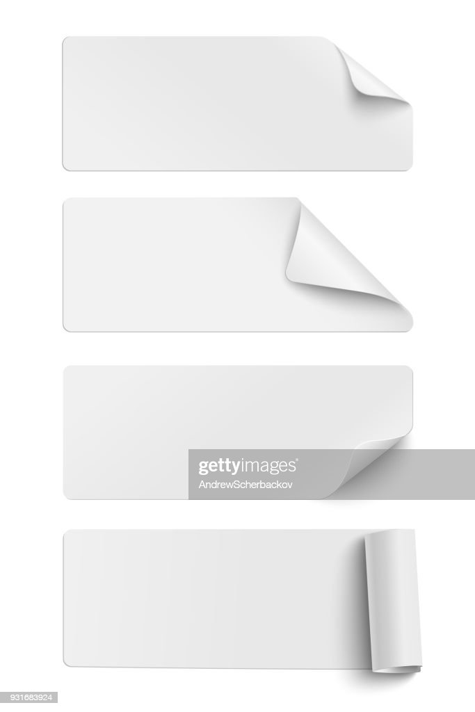 Set of oblong white sticky paper pieces. One piece has rolled end and others have curled corners  with shadow isolated on white background