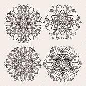 Set of ornate vector mandala symbols. Mehndi lace tattoo. Art Nouveau weave.