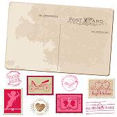 Set of pink and beige vintage postcard and postage stamps