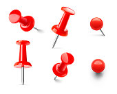Set of red push pins in different angles isolated on white background.