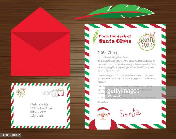 set of santa claus letters, envelope and quill pen on wooden background - message stock illustrations