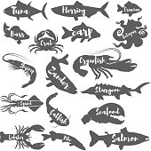 Set of seafood silhouettes with lettering.