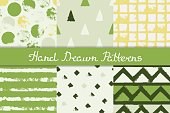 Set of seamless patterns with geometric designs. Circle, triangle, rhombus, stripe in green, gray, yellow, white. Hand drawn. Vector illustration.