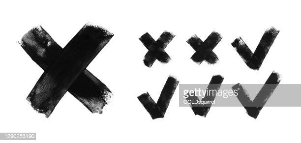 set of seven trendy flat examples of check mark and cross icons - hand painted by black acrylic paint on white paper background vector illustration with amazing uneven natural irregular brush strokes - graphic signs of truth or falsehood - cross shape stock illustrations