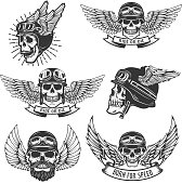 Set of skulls in winged motorcycle helmets. Design elements for label, emblem, sign, badge. Vector illustration