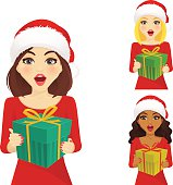 Set of surprised woman in christmas santa hat holding gift