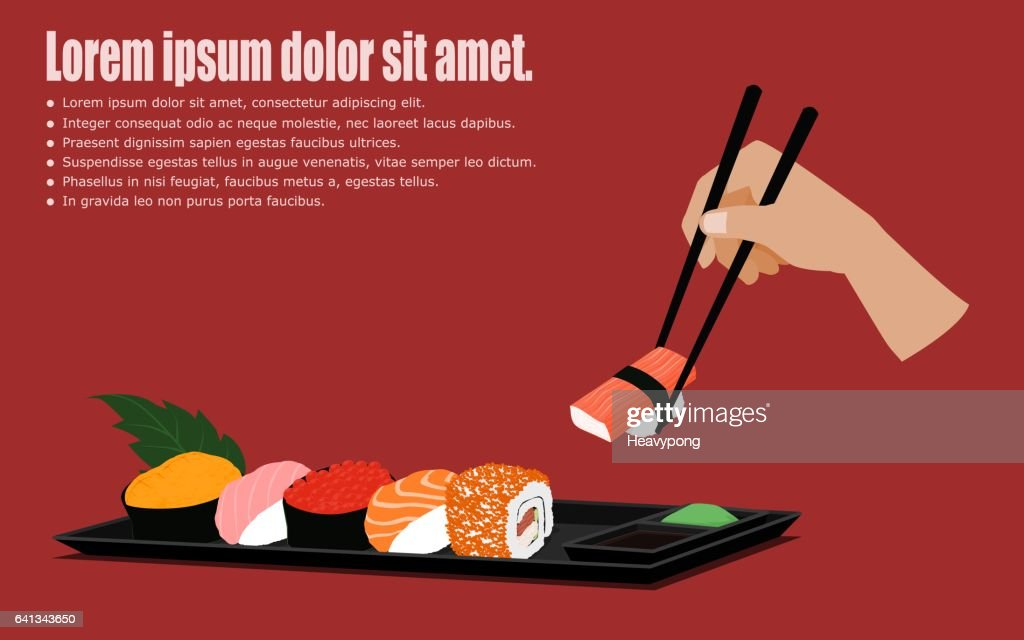 Set of Sushi on dish with hand holding chopsticks