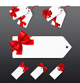 Set of tags with red bows on white background. Vector illustration.