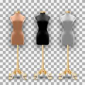 Set of three mannequins fashion of different colors on a gold pillars