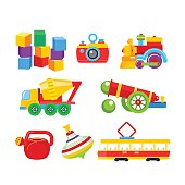 Set of vector children's toys. Isolated on a white background. Including cubes, locomotive, camera, mixer, gun, top, lake, tram.