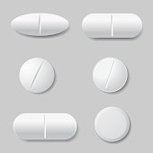 Set of vector illustrations of white medicine pills, round and oval - isolated on gray background