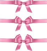 Set of vector realistic pink ribbons and bows.